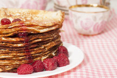 Pancakes with raspberry jam. Royalty Free Stock Photography