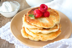 Pancakes with raspberry, mint and sour cream Stock Photos