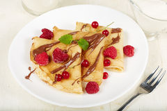 Pancakes with raspberry, red currant and chocolate. Dessert. Stock Photo