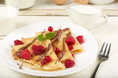 Pancakes with raspberry, red currant and chocolate. Dessert. Royalty Free Stock Photo