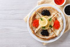 Pancakes with red and black caviar, horizontal top view Royalty Free Stock Photography