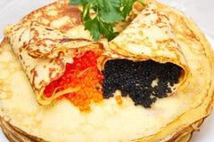 Pancakes with red and black caviar. Stock Photos