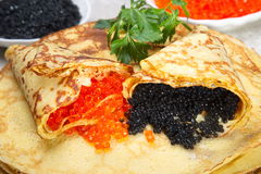 Pancakes with red and black caviar. Royalty Free Stock Images
