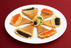 Pancakes with red and black roe Royalty Free Stock Photography