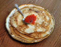 Pancakes with red caviar. On a table there is a plate with tasty pancakes and red caviar. Russian tradition Stock Photography