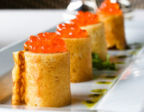 Pancakes  with red caviar. On the dish Stock Image