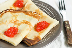 Pancakes with red caviar Royalty Free Stock Photography