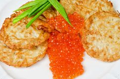 Pancakes with red caviar Stock Image