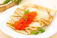 Pancakes with red caviar Stock Photography