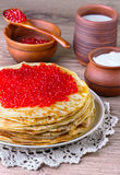 Pancakes with red caviar Stock Photos