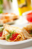 Pancakes with Red Caviar Stock Images