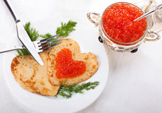 Pancakes with red caviar, heart Stock Photos
