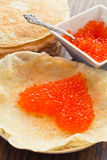 Pancakes with red caviar in a heart shape Royalty Free Stock Photos