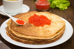 Pancakes with red caviar. Russian cuisine. Flat lay. Maslenitsa. Wooden background. Close-up. Pancakes with red caviar. Russian cuisine. Flat lay. Maslenitsa stock photography