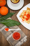 Pancakes with red caviar. Russian cuisine. Flat lay. Maslenitsa. Wooden background. Top view. Close-up. Pancakes with red caviar. Russian cuisine. Flat lay royalty free stock image