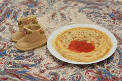 Pancakes with red caviar. Shrovetide stock photo
