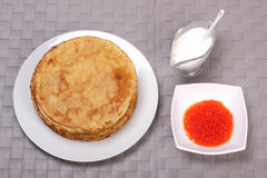 Pancakes, red caviar and sour cream Royalty Free Stock Photography