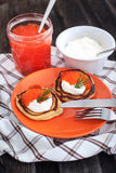 Pancakes with red caviar and sour cream Stock Photo