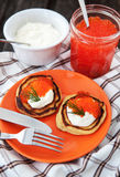 Pancakes with red caviar and sour cream Stock Photos