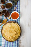 Pancakes with red caviar on a table Royalty Free Stock Photos