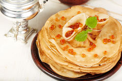 Pancakes with red caviar. Traditional Russian cuisine. Royalty Free Stock Photos