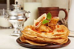 Pancakes with red caviar. Traditional Russian cuisine. Stock Photo