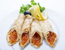 Pancakes with red caviar on white background. Russian traditional dish stock images