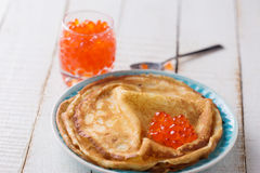 Pancakes with red caviar. Stock Images