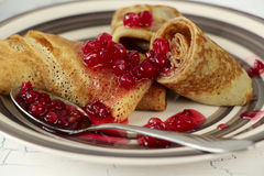 Pancakes with red currant jam close-up Royalty Free Stock Images
