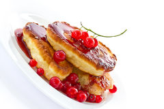 Pancakes with red currants Royalty Free Stock Photography