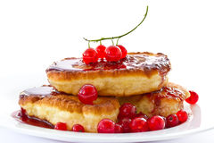 Pancakes with red currants Stock Photography
