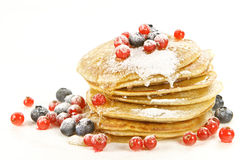 Pancakes with red currants and bilberries Stock Image