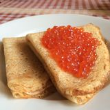 Pancakes with red salmon  Caviar on plate for dating valentines day concept, traditional Russian cuisine Royalty Free Stock Photos