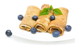 Pancakes and blueberries on a white background Stock Images