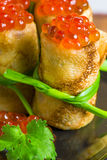 Pancakes rolled into rolls and caviar Stock Image