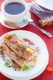 Pancakes rolled in a tube and a cup of tea Royalty Free Stock Photography