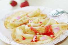 Pancakes with rose petals Stock Photos