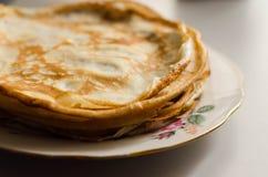 Pancakes or Russian Blintzes on white background. Selective focus. Pancakes or Russian Blintzes on white background stock photo
