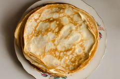 Pancakes or Russian Blintzes on white background. Selective focus. Pancakes or Russian Blintzes on white background stock images
