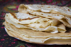 Pancakes. The Russian traditional dish, the main thing during  Shrovetide, a symbol of spring and the sun Royalty Free Stock Photo