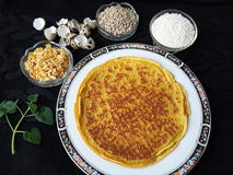 Pancakes with sago, sunflower seeds and rose petals and quail eggs. Pancakes with sago, sunflower seeds and rose petals, cooking for a vegetarian diet food with royalty free stock photography