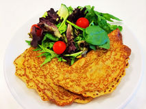Pancakes and salad Royalty Free Stock Images