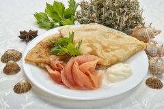 Pancakes with salmon. Breakfast. Good appetite for everyone royalty free stock image