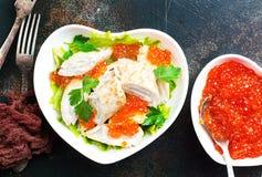 Pancakes with salmon caviar. Fried pancakes with red salmon caviar stock photography