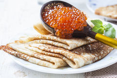 Pancakes with salmon caviar,  traditional Russian meal Royalty Free Stock Photo