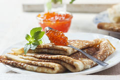 Pancakes with salmon caviar,  traditional Russian meal Royalty Free Stock Images