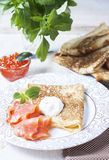 Pancakes with salmon caviar,  traditional Russian meal Stock Photography