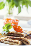 Pancakes with salmon caviar,  traditional Russian meal Stock Images