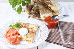 Pancakes with salmon caviar,  traditional Russian meal. Royalty Free Stock Photo