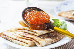 Pancakes with salmon caviar,  traditional Russian meal. Stock Photos